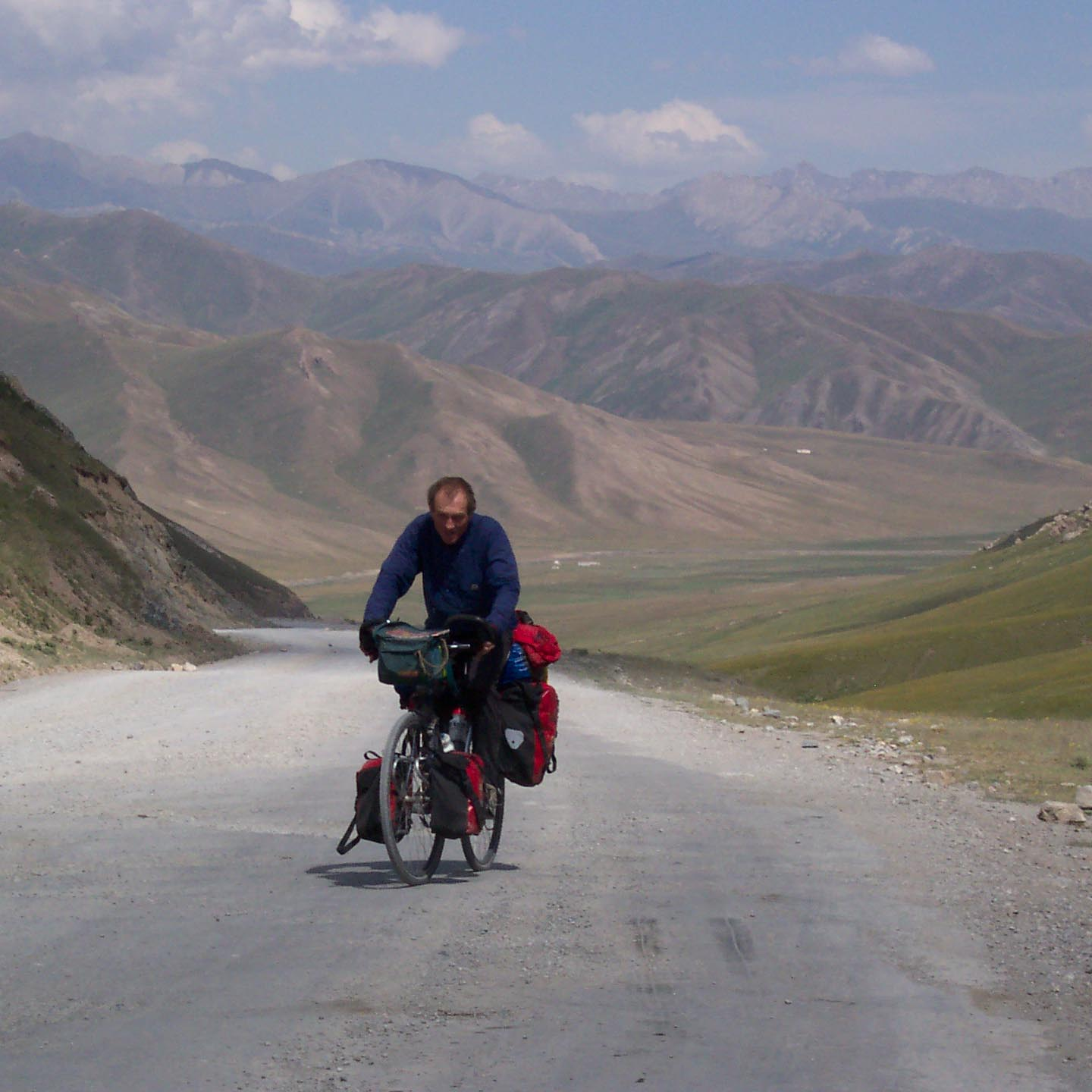 Adventure Cycling Guide Cycle Touring Information Tim Barnes hill climbing Kyrgyzstan